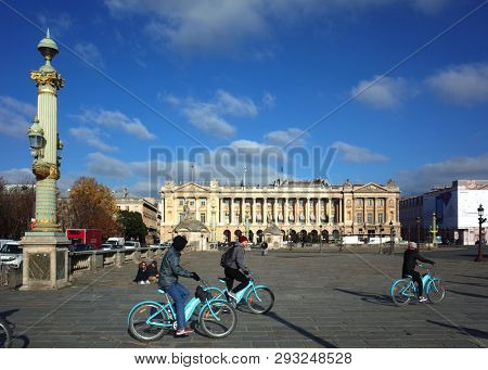 Paris, France - November 19, 2018: Cycling tour via Place de la Concorde with view over Hotel of Crillon - one of the oldest and most luxurious hotels in the world
