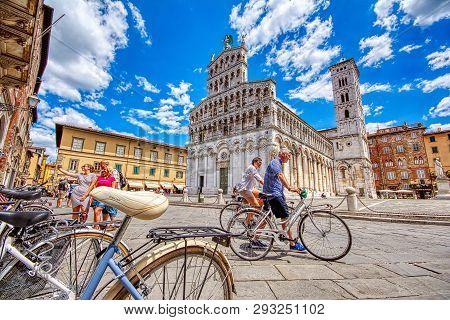 Lucca, Italy - June 26, 2018: View Of Medieval Cathedral San Michele In Lucca, Italy. Tourists Walki