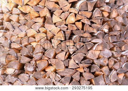 Woodpile. Firewood Stacked In A Woodpile. Birch Wood At Close Range.
