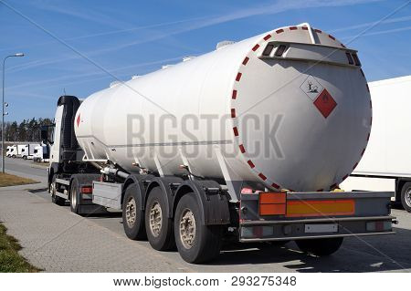 Truck With A Specialist Semi-trailer. Road Tanker Designed For The Carriage Of Dangerous Substances