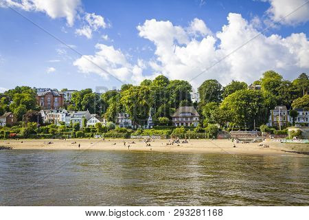 Hamburg, Germany - June 25, 2014: Summer View Of The Beach (strand Oevelgoenne) On The Elbe River In