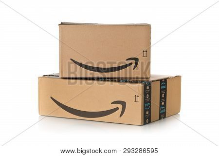 Dresden, Germany - April 3, 2019 : Stack Of Amazon Prime Parcels Over White Background. Prime Is A S