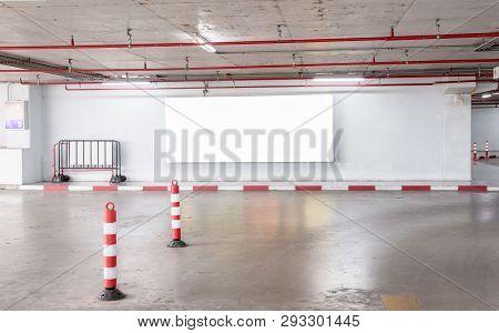 Parking Garage Underground Interior With Blank Billboard.empty Space Car Park Interior At Afternoon.