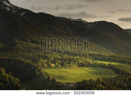 Funes Valley, Dolomites, Italy. Autumnal View Of The Valley With Colorful Trees And Odle Mountain On