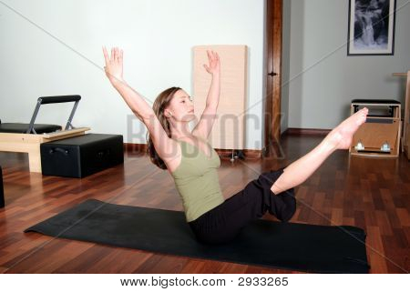 Professional Pilates Instructor Doing Floor Excercises