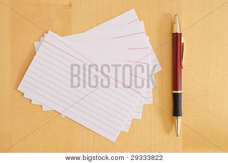 Blank Flash Cards With Pen On Desk