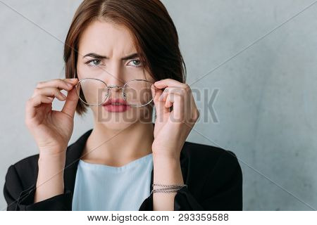 Closeup Of Young Business Lady Looking Confused, Taking Off Glasses. Professional Disagreement And D