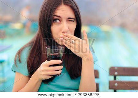 Woman Reacting After Having A Fizzy Soda Drink