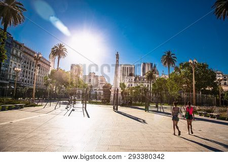 Buenos Aires Argentina - Dec 25, 2018: People walk on  Plaza de Mayo square in Buenos Aires, Argentina. It is the main square in the Monserrat barrio of central Buenos Aires.