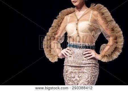Sofia, Bulgaria - 19 September, 2018: Female Model Walks The Runway In Beige Skirt Isolated On A Bla