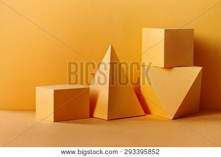 Yellow Geometrical Figures Still Life Composition. Three-dimensional Prism Pyramid Rectangular Cube