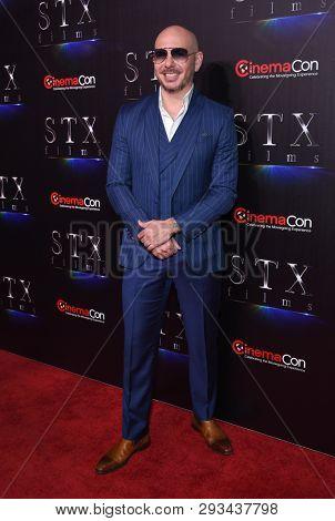 LAS VEGAS - APR 02:  Pitbull aka Armando Christian Perez arrives for the CinemaCon 2019 - STXfilms presentation