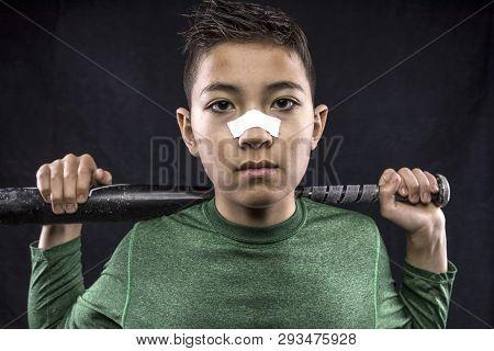 A Studio Portraiture Of A Boy Holding A Baseball Bat.