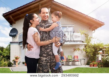 Close-up Of A Happy Soldier Reunited With Family Outside Their Home
