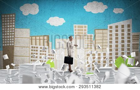 Business Woman In Suit Standing Among Flying Documents And Looking At Watch With Sketched Cityscape