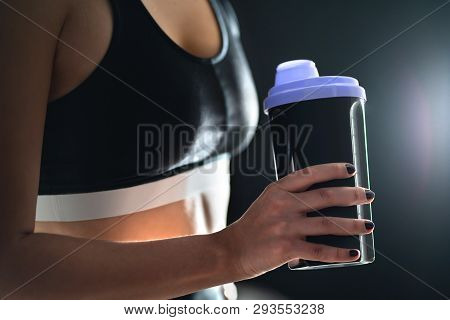 Protein Shake After Workout And Gym Training. Fit Woman Holding Bottle Of Sport Drink, Whey Or Healt