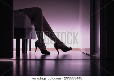 Escort, Prostitute Or Sugar Babe Lying On Bed With Long Legs And Sexy High Heels. Prostitution, Sex