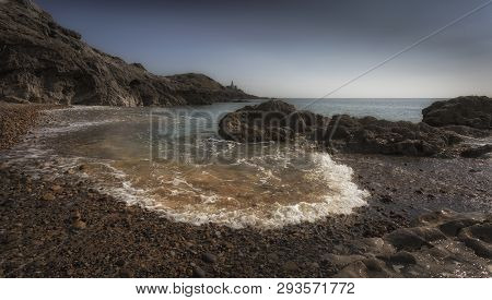 Incoming Tide At Mumbles Lighthouse And Bracelet Bay On The Gower Peninsula In Swansea, South Wales,