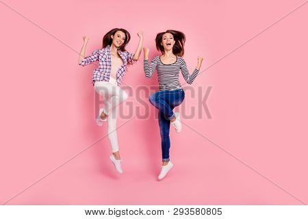 Full length body size view photo of funny active fellows fellowship scream laugh shout yes laughter raise fists satisfied feel rejoice isolated pastel background wear denim checkered outfit poster