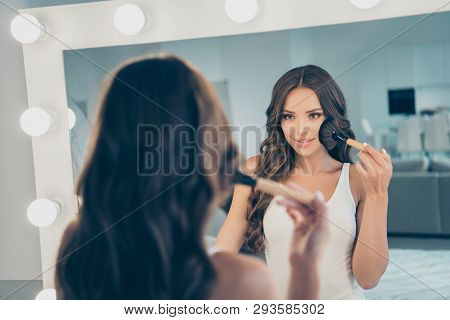 Close-up portrait of her she nice-looking sweet tender winsome attractive lovely lovable fascinating wavy-haired lady preparing date disco party applying cc bb cream in light white interior room poster
