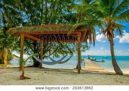Hammocks Under A Hut On South Hole Sound In Front Of A Pier On The Caribbean Sea, Little Cayman, Cay