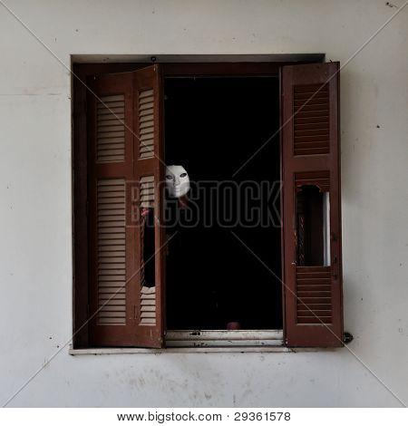 Masked Figure And Broken Window Shutter