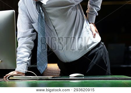 Close-up View Of Elderly Man-reception Worker Hotel Manager With Pain In Kidneys. Man With Back Ache
