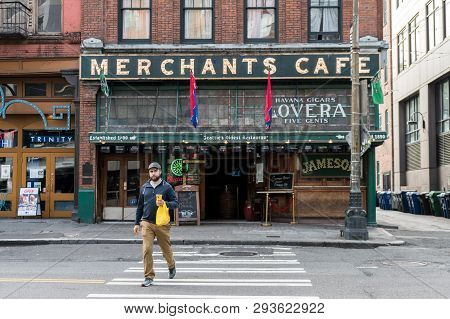 Seattle, Washington, Usa - October 18, 2019: A Young Man Walks In Front Of Merchants Cafe, The Oldes