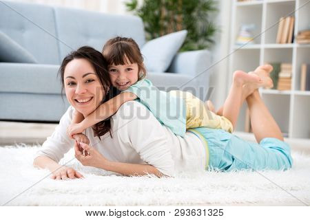 Happy Loving Family. Beautiful Mother And Little Daughter Have Fun, Play In The Room On The Floor, H