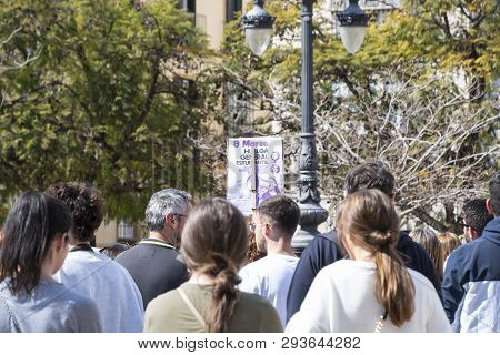 Malaga, Spain - March 8, 2019: Crowd Marching In Central Malaga At The International Womans Day For