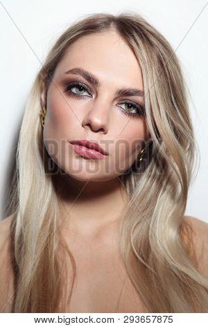 Young beautiful woman with smoky eye make-up