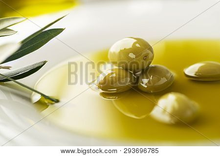 Healthy Olive Oil With Olives Ingredients Close Up. Healthy Concept
