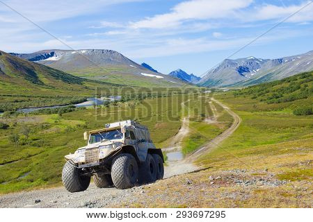 Yamal, Russia - August 27, 2018: Trеkol All-terrain Vehicle Climbs The Mountain In The Foothills Of
