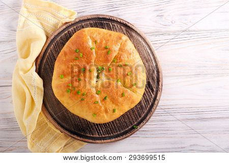 Savory Pie With Cheese And Spring Onions On Board
