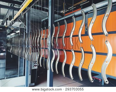 Industrial Automatic Painting Technology. Powder Coatings. Metalworking.