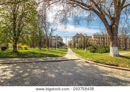 Urban Scenery In Springtime. Beautiful Park With Paved Walkways. Location Narodna Square, Uzhgorod,