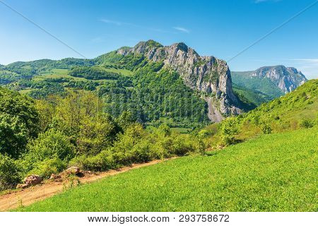 Springtime In Alba Country, Romania. Wonderful Sunny Day In Mountainous Countryside. Grassy Hillside