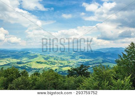 Beautiful Mountain Landscape In Summer. Settlement On Rolling Hills Down In The Distant Valley. Wond