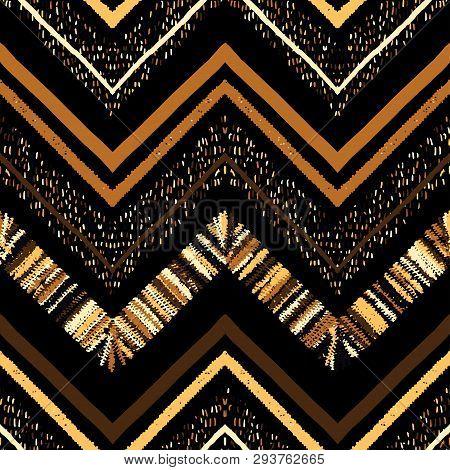 Seamless Gold Metallic Ethnic Zigzag Chevron Pattern.