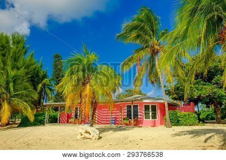 Little Cayman, Cayman Islands, Nov 2018, Pink Caribbean-style House On South Hole Sound