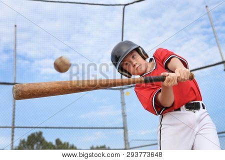 Young batter hitting the ball in a youth Baseball game
