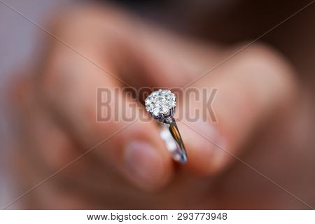 Close-up Of A Ring In A Mans Hand. Young Man Giving Engagement Ring To His Girlfriend. Man Making Ma