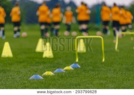 Sports Soccer Football Training Practice Session. Blurred Sports Background. Soccer Training Equipme