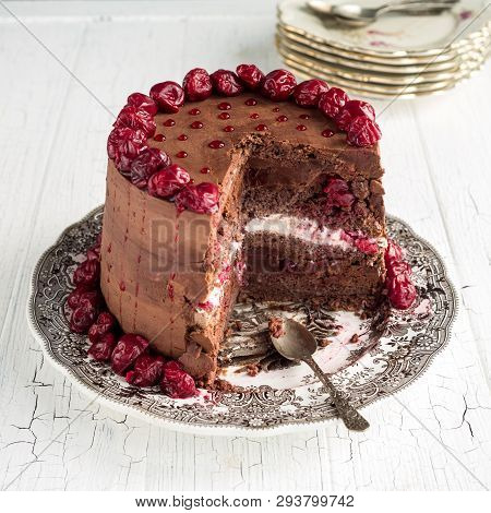 Sour Cherry Chocolate Cake On A White Wooden Table Board