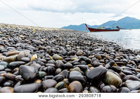 Beautiful Nature Landscape Of Rock With Unusual Black Color And Long Tail Boat Trip Floating In The