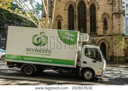 Sydney, Australia - February 12, 2019: Delivery Van Of Woolworths Retail Giant. Back Is Yellow Facad