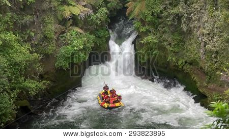 Rotorua, New Zealand- December, 2 2015: A Group Of Thrill Seekers Whitewater Rafting The Kaituna Riv