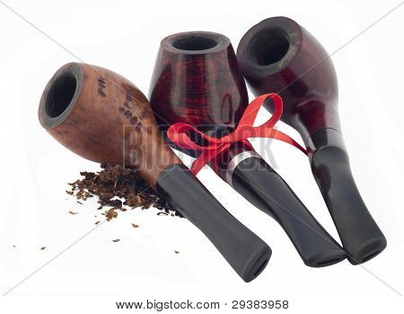 Three Pipe With Scattered Tobacco And With A Red Ribbon.