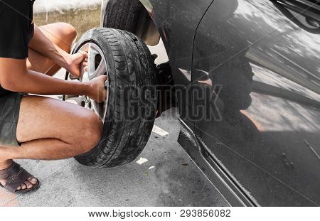 Change A Flat Car Tire At Car Park With Tire Maintenance, Damaged Car Tyre.