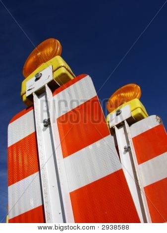 Two Orange And White Barricades